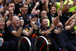 The Red Bull team celebrate with Daniel Ricciardo, Red Bull Racing next to the swimming pool on the