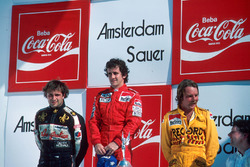 Podium: race winner Alain Prost, second place Keke Rosberg, third place Elio de Angelis