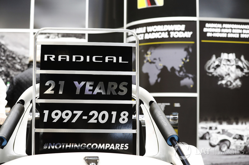 A sign displaying 21 years of Radical