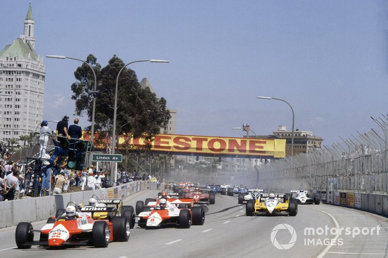 Andrea de Cesaris, Alfa Romeo 182 leads Niki Lauda, McLaren MP4/1B-Ford Cosworth, Rene Arnoux, Renault RE30B, Alain Prost, Renault RE30B, Bruno Giacomelli, Alfa Romeo 182, Gilles Villeneuve, Ferrari 126C2, Nelson Piquet, Brabham BT49D-Ford Cosworth and Keke Rosberg, Williams FW07C-Ford Cosworth, at the start