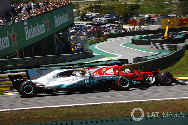 Sebastian Vettel, Ferrari SF70H, passes Valtteri Bottas, Mercedes AMG F1 W08, at the start