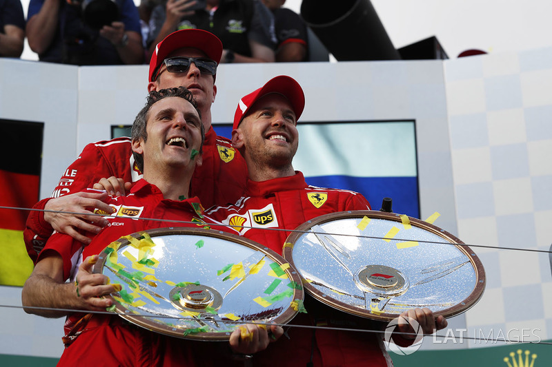 Race winner Sebastian Vettel, Ferrari celebrates on the podium with Kimi Raikkonen, Ferrari and the trophies