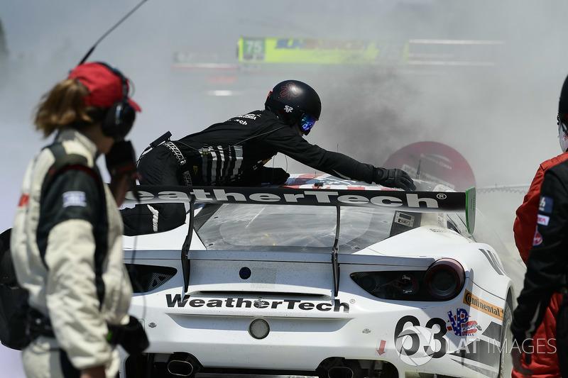 #63 Scuderia Corsa Ferrari 488 GT3, GTD: Cooper MacNeil, Gunnar Jeannette, Jeff Segal pit stop pit lane fire