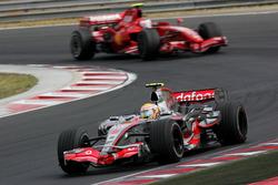 Lewis Hamilton, Mclaren MP4-22 leads Kimi Raikkonen, Ferrari F2007