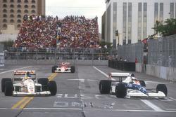 Jean Alesi Tyrrell 018 Ford laps Michele Alboreto, Arrows A11B Ford with Ayrton Senna, Mclaren MP4/5