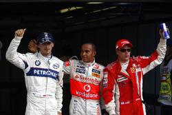 Robert Kubica, BMW Sauber F1.08, Lewis Hamilton, McLaren MP4-23 and Kimi Raikkonen, Ferrari F2008 celebrate in Parc Ferme