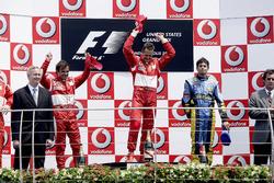 Podium: second place Felipe Massa, Ferrari, Race winner Michael Schumacher, Ferrari, third place Giancarlo Fisichella, Renault F1 Team