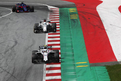 Sergey Sirotkin, Williams FW41, leads Marcus Ericsson, Sauber C37, and Brendon Hartley, Toro Rosso STR13, to the grid