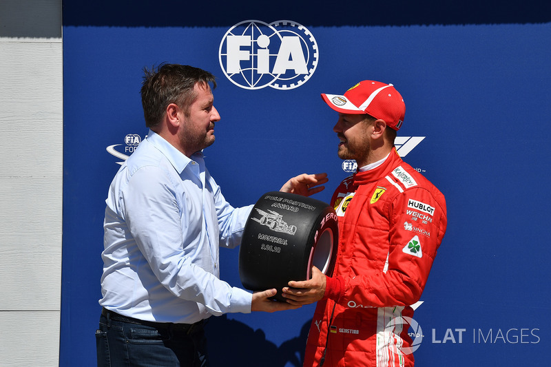 Sebastian Vettel, Ferrari receives the Pirelli Pole Position Award from Paul Hembery, Pirelli Motors