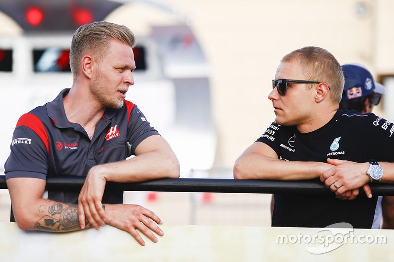 Kevin Magnussen, Haas F1 Team, with Valtteri Bottas, Mercedes AMG