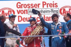 Niki Lauda, 1st position, Jody Scheckter, 2nd position and Hans-Joachim Stuck, 3rd position on the podium