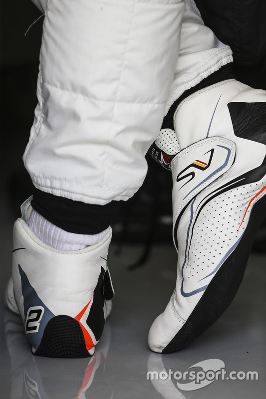 The boots of Stoffel Vandoorne, McLaren