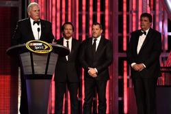 Rick Hendrick, musician Edddie Vedder, Tony Stewart and NASCAR vice chairman Mike Helton