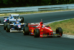 Michael Schumacher, Ferrari F310B voor Jacques Villneuve, Williams
