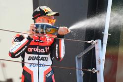 Marco Melandri, Ducati Team, fête sa victoire sur le podium