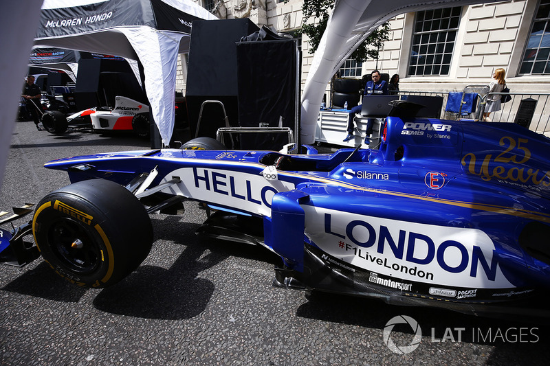The Sauber Formula 1 team display a message of