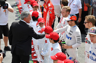 Chase Carey, Chief Executive Officer and Executive Chairman of the Formula One Group and Sergio Perez, Racing Point Force India on the grid