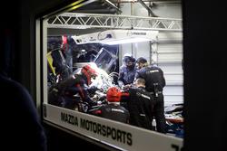 Mechanics working on the car of #70 Mazda Motorsports Mazda DPi: Joel Miller, Tom Long, James Hinchcliffe