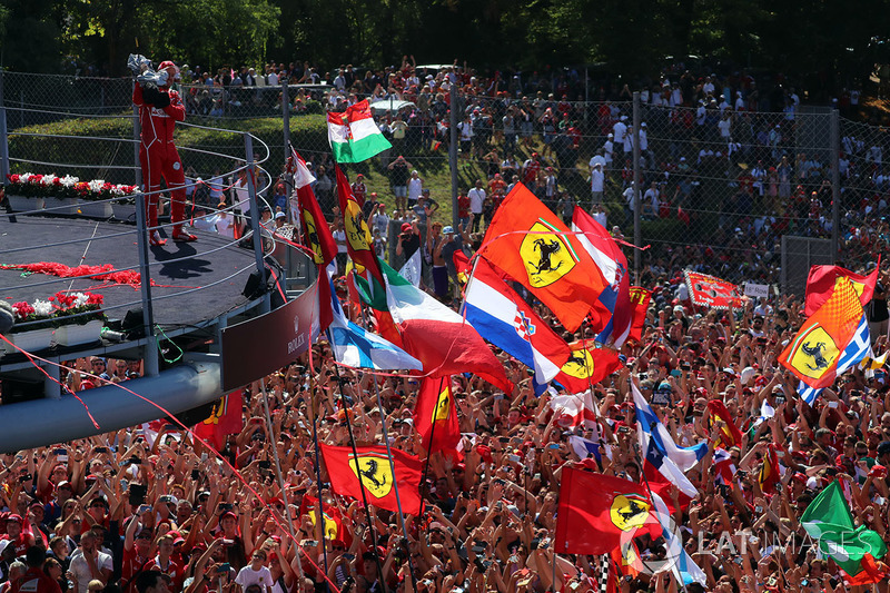 Sebastian Vettel, Ferrari celebrates on the podium, the Ferrari fans and flags