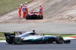 Lewis Hamilton, Mercedes-Benz F1 W08  passes race retiree Kimi Raikkonen, Ferrari SF70H