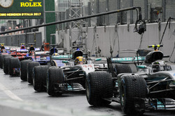 Cars line up in pitlane