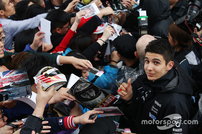 Esteban Ocon, Force India, signs autographs for fans