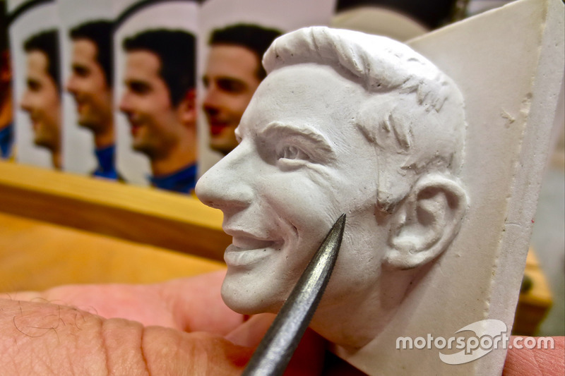 Sculptor William Behrends adds finer details to the ceramic likeness of 2016 Indianapolis 500 winner Alexander Rossi's image before it is cast in sterling silver