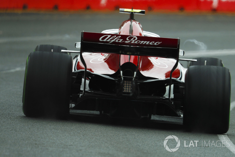 Vortices swirl off the rear wing on the Charles Leclerc Sauber C37 Ferrari
