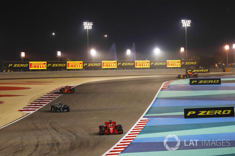 Sebastian Vettel, Ferrari SF71H, leads Valtteri Bottas, Mercedes AMG F1 W09, and Kimi Raikkonen, Fer