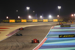 Sebastian Vettel, Ferrari SF71H, leads Valtteri Bottas, Mercedes AMG F1 W09, and Kimi Raikkonen, Ferrari SF71H