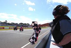 Marco Melandri, Aruba.it Racing-Ducati SBK Team takes chequered flag from Jonathan Rea, Kawasaki Racing Courtesy of WorldSBK