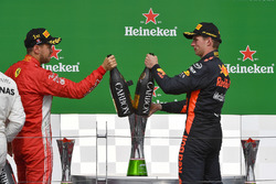 Sebastian Vettel, Ferrari and Max Verstappen, Red Bull Racing celebrate on the podium with the champ
