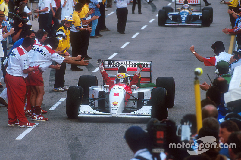 Ayrton Senna, McLaren celebrates 1st position on the way down the pit lane to parc ferme