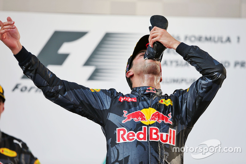 Race winner Daniel Ricciardo, Red Bull Racing celebrates on the podium by drinking champagne from hi