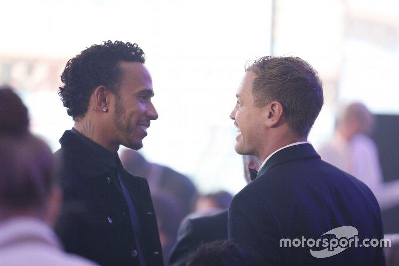 Sebastian Vettel, Ferrari con Lewis Hamilton, Mercedes-AMG F1