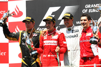Kimi Raikkonen, Lotus F1, Fernando Alonso, Ferrari, Michael Schumacher, Mercedes AMG F1 and Andrea Stella, Ferrari Race Engineer celebrates on the podium