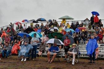 Race fans in the rain