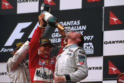 Podium: Race winner David Coulthard, McLaren Mercedes; second place Michael Schumacher, Ferrari; third place Mika Hakkinen, McLaren Mercedes