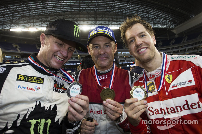 Petter Solberg, Tom Kristensen y Sebastian Vettel, con los medios