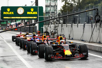 Daniel Ricciardo, Red Bull Racing RB13, Max Verstappen, Red Bull Racing RB13, at the front of the pit lane queue