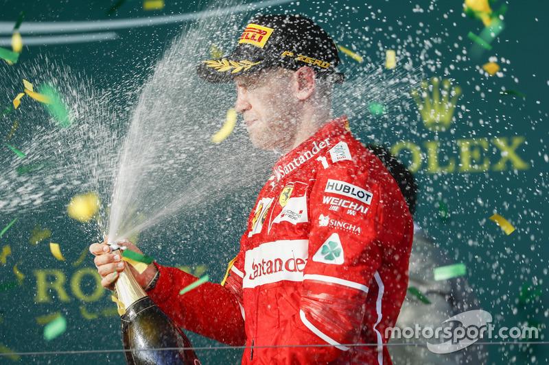 Sebastian Vettel, Ferrari, 1st Position, blasts himself with Champagne on the podium