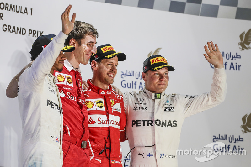 Lewis Hamilton, Mercedes AMG, second place, Matteo Togninalli, Chief Race Engineer, Ferrari, Sebastian Vettel, Ferrari, race winner, Valtteri Bottas, Mercedes, third place, on the podium