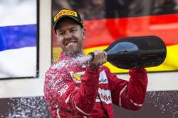 Race winner Sebastian Vettel, Ferrari celebrates in on the podium with the champagne