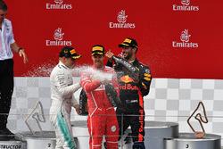 Sebastian Vettel, Ferrari, Valtteri Bottas, Mercedes AMG F1, Daniel Ricciardo, Red Bull Racing celebrate on the podium, the champagne