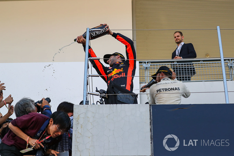 Daniel Ricciardo, Red Bull Racing and Lewis Hamilton, Mercedes AMG F1 celebrate on the podium with the champagne and the fans and photographers