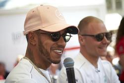Lewis Hamilton, Mercedes AMG F1, and Valtteri Bottas, Mercedes AMG F1 on stage
