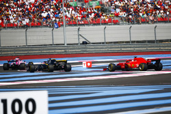 Sergio Perez, Force India VJM11, leads Nico Hulkenberg, Renault Sport F1 Team R.S. 18, and Sebastian Vettel, Ferrari SF71H