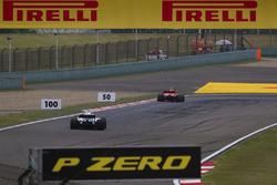 Kimi Raikkonen, Ferrari SF71H, leads Sergey Sirotkin, Williams FW41 Mercedes