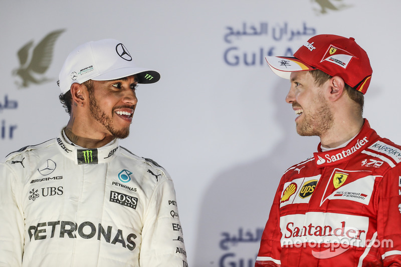 Lewis Hamilton, Mercedes AMG, second place, Sebastian Vettel, Ferrari, race winner, on the podium