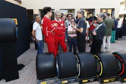 Roberto Boccafogli, Pirelli Head of F1 Communications, Maurizio Arrivabene, Team Principal, Ferrari, the new 2018 tyres
